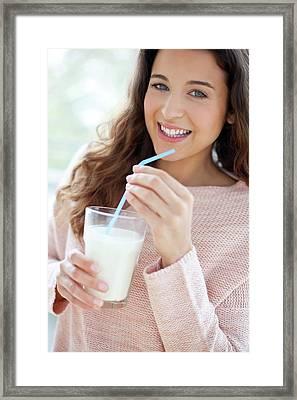 Woman With Glass Of Milk Framed Print by Ian Hooton