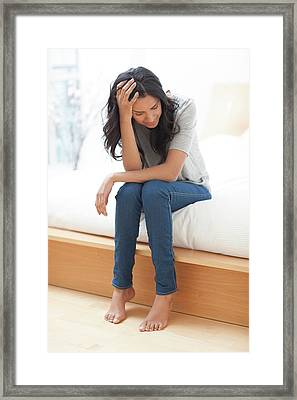 Woman With Her Head In Hands Framed Print by Ian Hooton
