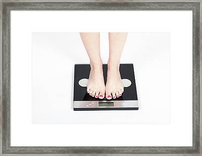 Woman's Feet On Scale Framed Print by Photostock-israel