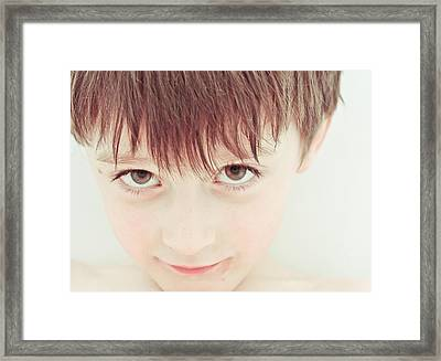 Young Boy Framed Print by Tom Gowanlock