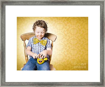 Young Boy Unwrapping Easter Egg Present Framed Print by Jorgo Photography - Wall Art Gallery