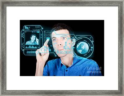 Young Man Using Futuristic Virtual Interface Framed Print by Jorgo Photography - Wall Art Gallery