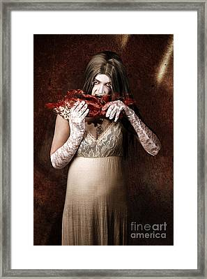 Zombie Vampire Woman Eating Human Hand Framed Print by Jorgo Photography - Wall Art Gallery