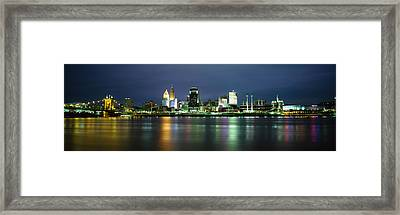 Buildings At The Waterfront Lit Framed Print by Panoramic Images