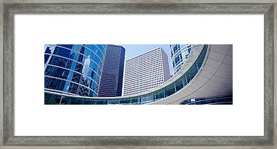 Low Angle View Of Buildings In A City Framed Print by Panoramic Images