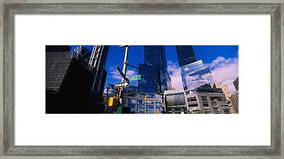 Low Angle View Of Skyscrapers Framed Print by Panoramic Images
