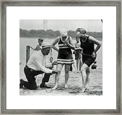 1920's Officer Measuring Bathing Suits Framed Print by Jeff Taylor