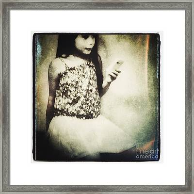 A Girl With Iphone Framed Print by Elena Nosyreva