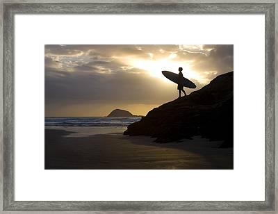 A Surfer On Muriwai Beach New Zealand Framed Print by Deddeda