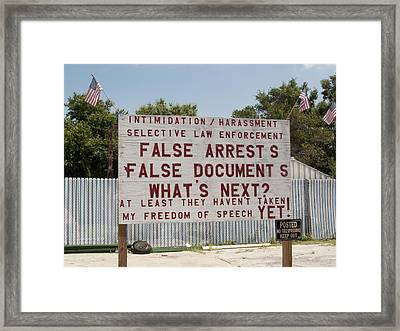 A Very Funny Sign Framed Print by Carl Purcell