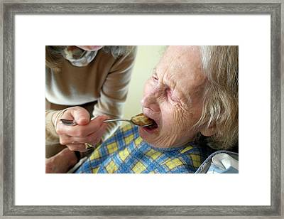 Alzheimer's Patient Being Fed Framed Print by Tony Craddock