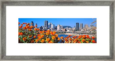 Blooming Flowers With City Skyline Framed Print by Panoramic Images