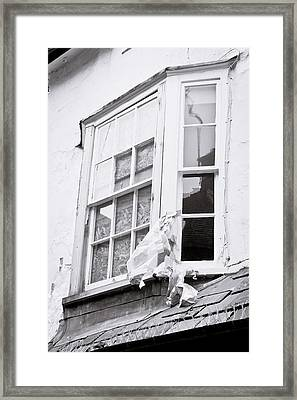 Boarded Up Window Framed Print by Tom Gowanlock