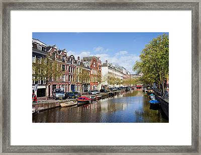 Boats On Amsterdam Canal Framed Print by Artur Bogacki