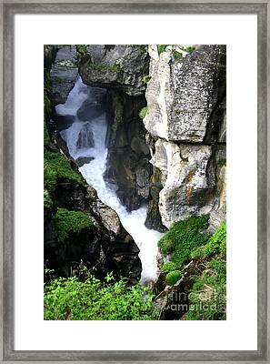 Faces In The Rocks Framed Print by Mukta Gupta