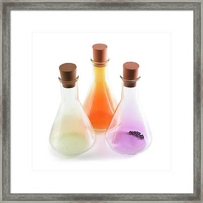 Flasks Containing Halogens Framed Print by Science Photo Library
