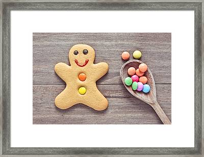 Gingerbread Man Framed Print by Tom Gowanlock