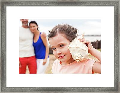 Girl With Seashell Framed Print by Ian Hooton