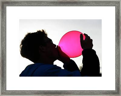 Inhaling Nitrous Oxide From A Balloon Framed Print by Cordelia Molloy