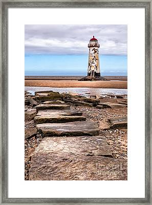 Lighthouse Steps Framed Print by Adrian Evans