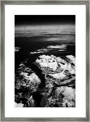 Looking Out Of Aircraft Window Over Snow Covered Fjords And Coastline Of Norway Europe Framed Print by Joe Fox