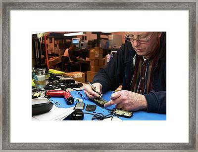 Mobile Phone Recycling Framed Print by Jim West