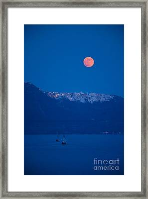Moon Over Santorini Framed Print by Brian Jannsen