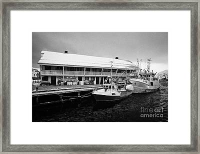 old warehouses and small fishing boats Honningsvag harbour finnmark norway europe Framed Print by Joe Fox