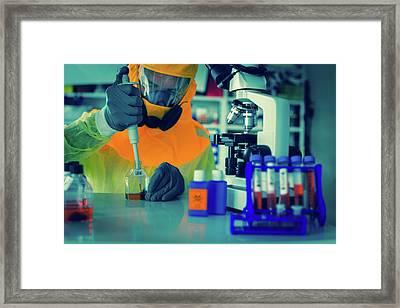 Scientist In Hazmat Suit Framed Print by Wladimir Bulgar