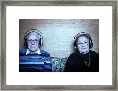 Senior Couple Wearing Headphones Framed Print by Mauro Fermariello