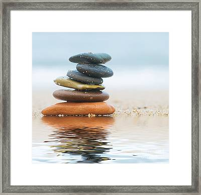 Stack Of Beach Stones On Sand Framed Print by Michal Bednarek