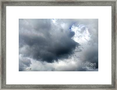 Storm Clouds Framed Print by J McCombie