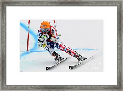 Ted Ligety Skiing  Framed Print by Lanjee Chee