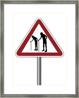 Warning Sign With Elderly People Symbol Framed Print by Alfred Pasieka