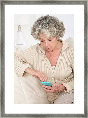 Woman Holding Smartphone Framed Print by Lea Paterson