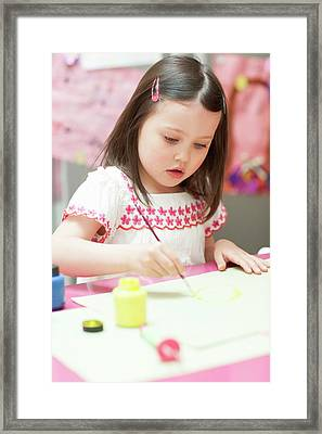 Young Girl Painting Framed Print by Ian Hooton