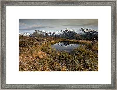 Alpine Lake Framed Print by Lorenzo Tonello