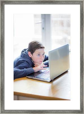 Boy Using A Laptop Framed Print by Samuel Ashfield