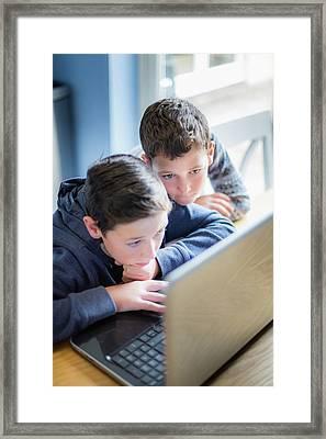 Boys Using Laptop Framed Print by Samuel Ashfield