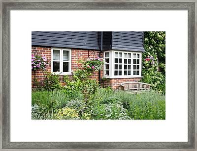 Cottage Garden Framed Print by Tom Gowanlock