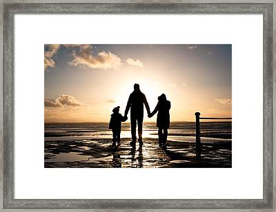 Family At The Coast Framed Print by Tom Gowanlock