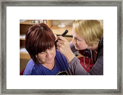 Gp Examining Patient Framed Print by Jim Varney