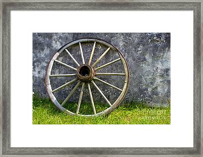 Antique Wagon Wheel Framed Print by Olivier Le Queinec