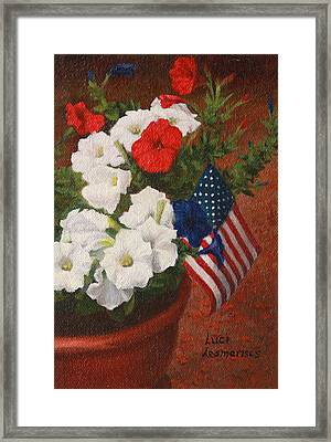 Potted Petunias Framed Print by Luci Lesmerises