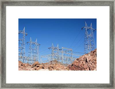 Pylons Taking Hydro Electricity Framed Print by Ashley Cooper