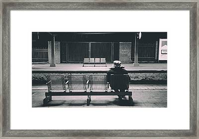 Reading While Waiting For The Train Framed Print by Mountain Dreams