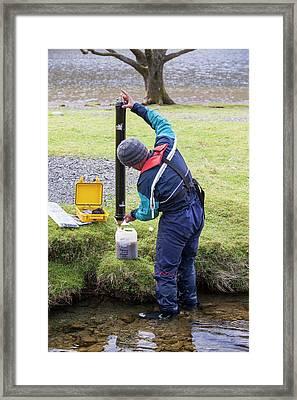 Scientist Emptying Sediment Trap Framed Print by Ashley Cooper