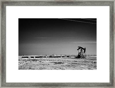 snow covered prairie agricultural farming land with pumpjacks oilfield winter Forget Saskatchewan Ca Framed Print by Joe Fox