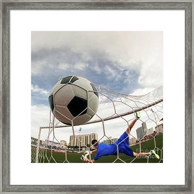Soccer Ball In Goal  Framed Print by Anek Suwannaphoom