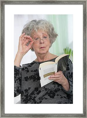 Woman Reading A Book Framed Print by Lea Paterson